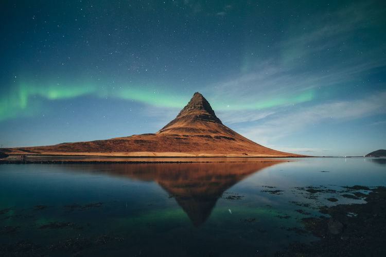 Iceland Aurora Aurora Borealis Aurora Polaris Northern Lights Sky Beauty In Nature Scenics - Nature Water Tranquil Scene Tranquility Reflection Mountain Idyllic Nature Star - Space No People Night Lake Astronomy Space Non-urban Scene Galaxy Mountain Peak Kirkjufell