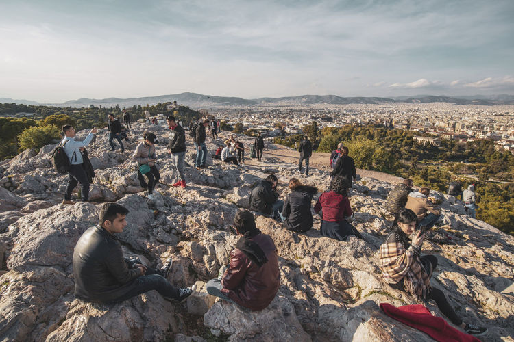 Acropolis Athens Greece Acropolis Sky Real People Group Of People Crowd Leisure Activity Nature Lifestyles Day Mountain Cloud - Sky Men Adult People Women Environment Rock Architecture Rock - Object Land Outdoors