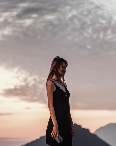 Sunset moment One Person Sky Cloud - Sky Three Quarter Length Adult Standing Real People Young Adult Women Sunset Hairstyle Outdoors Young Women Leisure Activity Side View Nature Lifestyles Casual Clothing Looking Land The Modern Professional