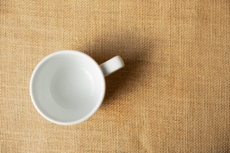 Top view empty white mug Above Background Beverage Blank Breakfast Bright Cafe Ceramic Ceramics Clean Closeup Coffee Collection Color Cup Design Dish Dishware Domestic Drink Empty Espresso Home Hygiene Isolated Kitchen Light Morning Mug Nobody Object Plate Porcelain  Saucer Space Studio Tableware Tea TeaCup Top View Water White
