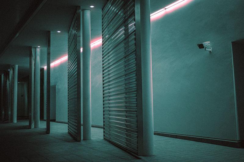 Illuminated lights on building wall at night