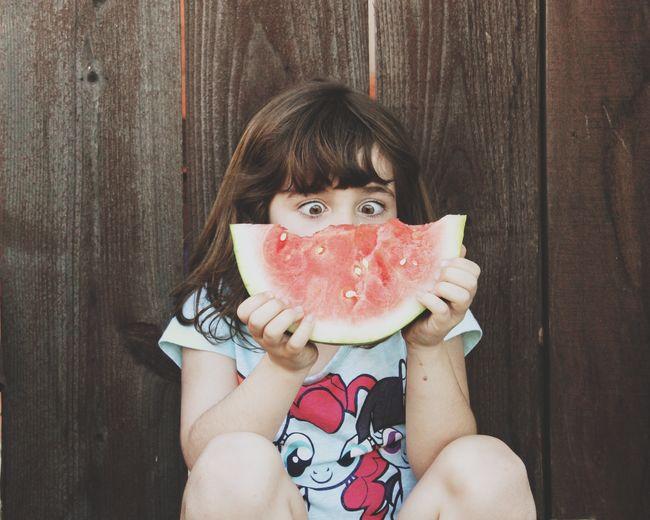 Portrait of baby girl eating food