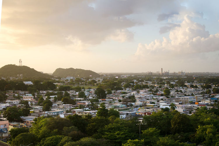 Avenida Piñero, San Juan, Puerto Rico. City view from top looking at sunset. Puerto Rico San Juan Architecture Building Building Exterior Caribbean City City View  Cityscape Cloud - Sky Day High Angle View No People Sky Sunlight Town United States Of America