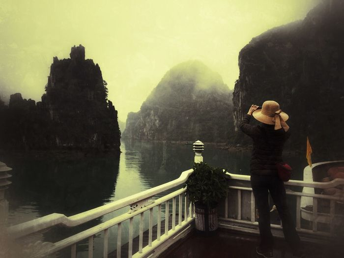 Rear View Of Woman On Pier At Halong Bay