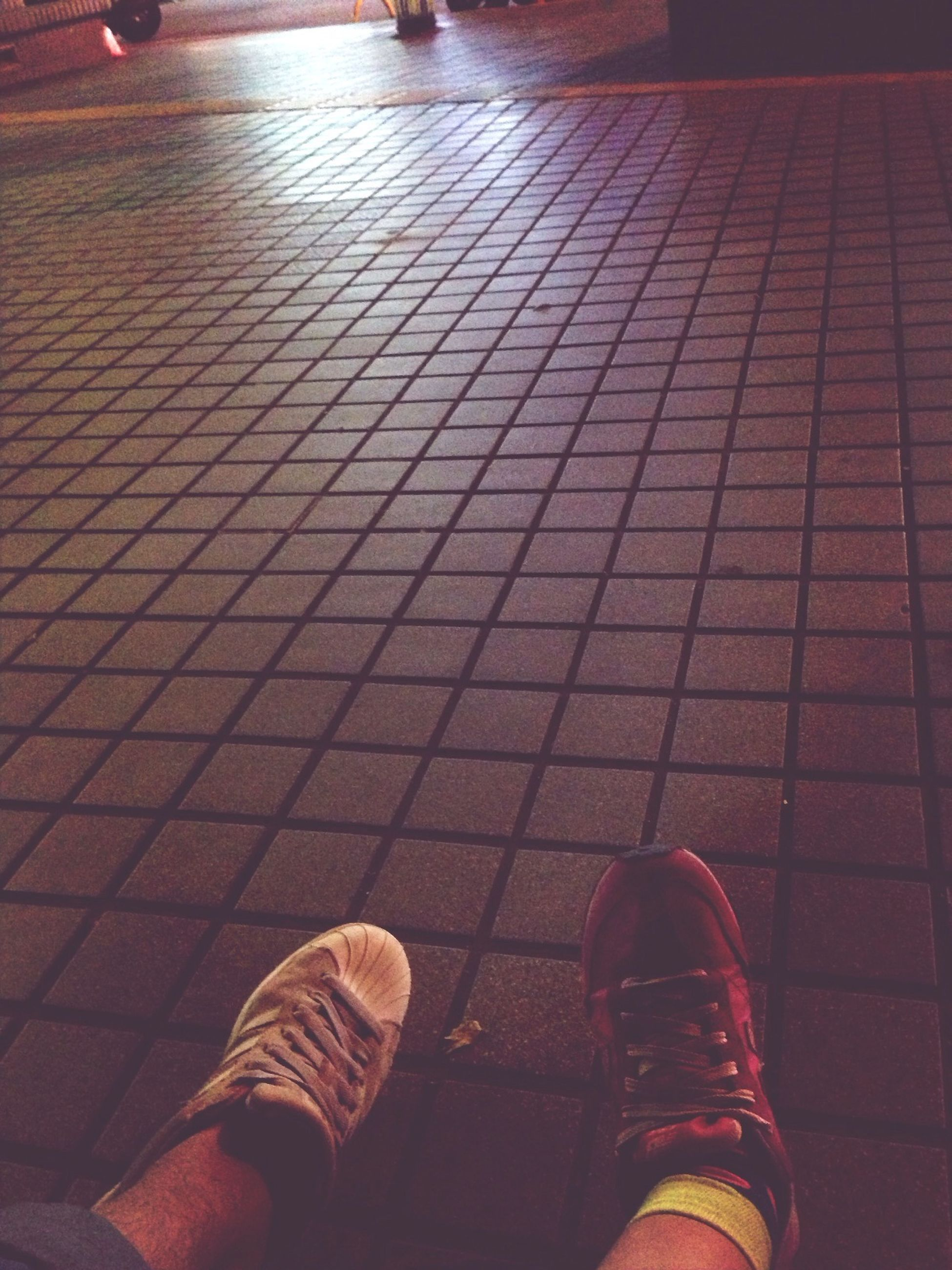 indoors, wall - building feature, pattern, flooring, absence, illuminated, empty, tiled floor, chair, high angle view, lighting equipment, no people, tile, shoe, architecture, built structure, shadow, wall, sunlight, design