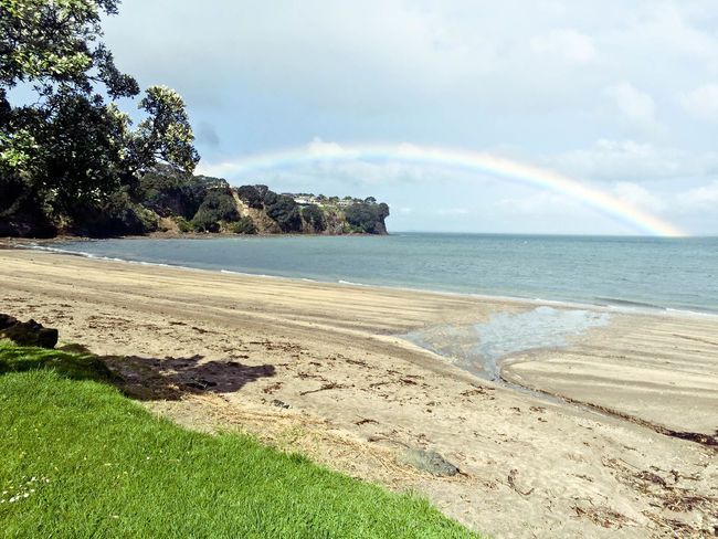 Arkles Bay Beach Beauty In Nature Cloud - Sky Day Horizon Over Water Nature New Zealand No People Outdoors Rainbow Rainbow Sky Sand Scenics Sea Shore Sky Tranquil Scene Tranquility Tree Water