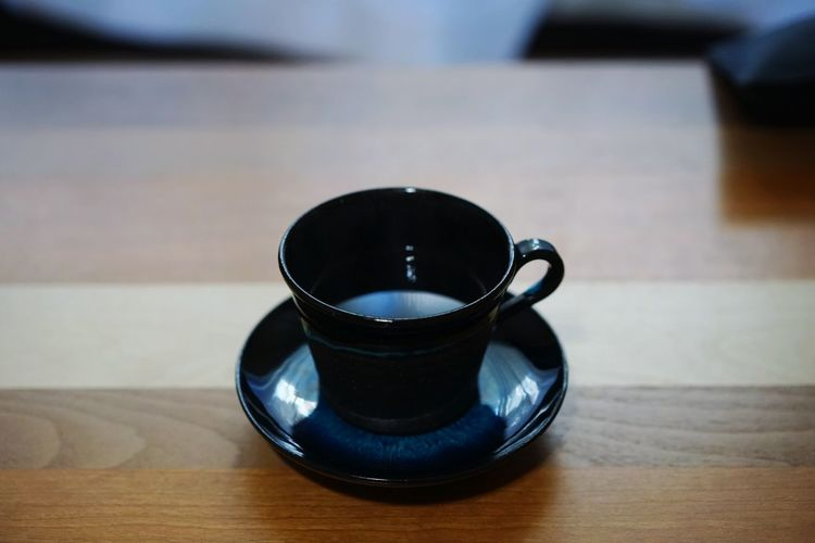 A bleu sky reflected on the surface of cup of coffee.A Blue Sky Reflected On The Surface Of The Waterdrink Indoors  Table Refreshment Close-up Freshness Healthy Eating No People Day Coffee - Drink Japan Home Interior Lifestyles Food And Drink Coffee Time Coffee Cup Coffeelover