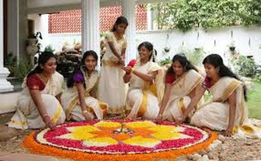 It is a Kerala young women doing flower decoration Young Women