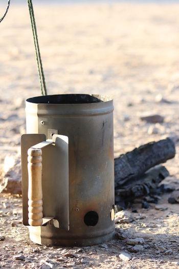 Close-up of old tea light on beach