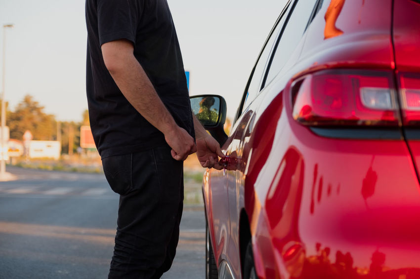 Man opening door to red car Enter Red Car Car Door Car Door Handle Casual Clothing Day Filling Focus On Foreground Fuel Pump Gas Station Gasoline Land Vehicle Men Midsection Mode Of Transportation Motor Vehicle One Person Outdoors Real People Red Car Refueling Renault Standing Transportation