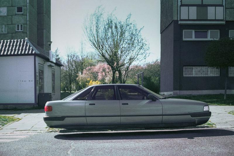 Car on street against buildings