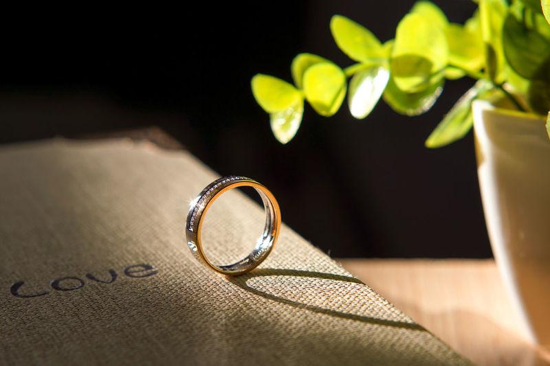 Close-up of wedding ring on burlap