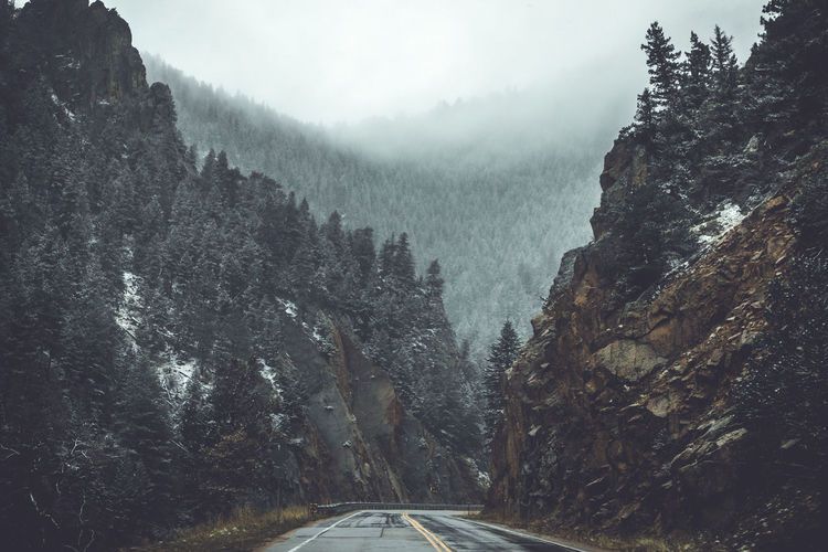 Beauty In Nature Cold Temperature Day Environment Fog Land Landscape Mountain Nature No People Non-urban Scene Outdoors Plant Road Scenics - Nature Tranquil Scene Tranquility Transportation Tree Winter