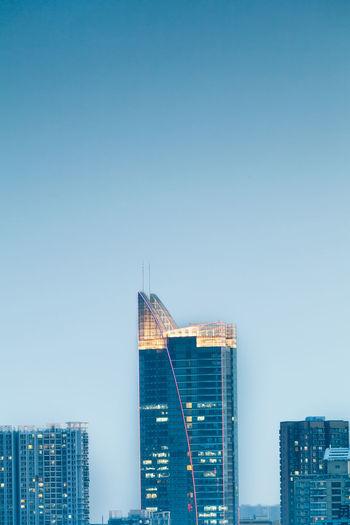 Buildings Against Clear Blue Sky At Dusk