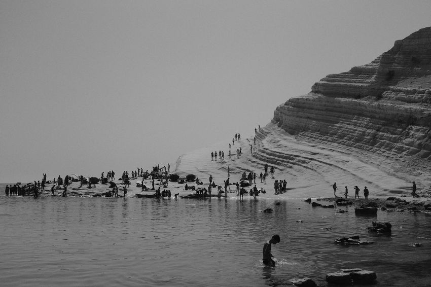 Scala dei Turchi Summer Southern Italy Blackandwhite Scala Dei Turchi Blackandwhite Beach Italy Sicily Large Group Of People Real People Nature Clear Sky Travel Destinations Men Copy Space Lifestyles