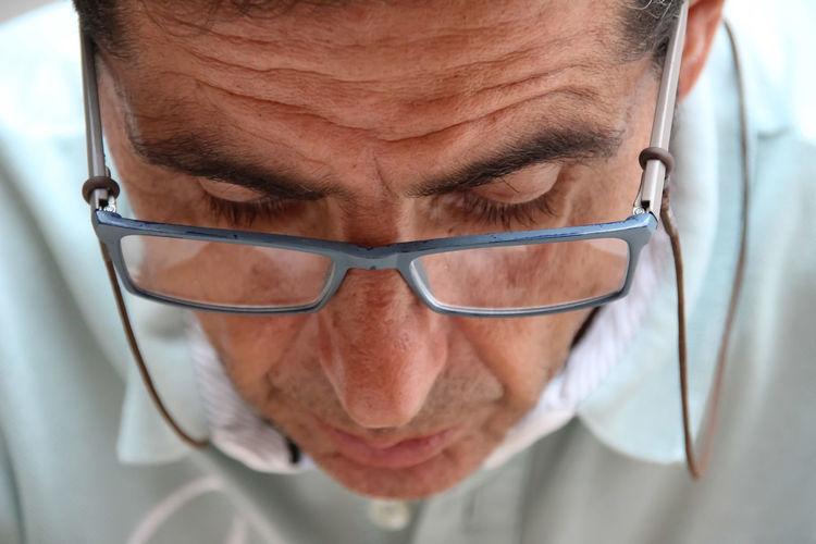 Close-up of man wearing eyeglasses