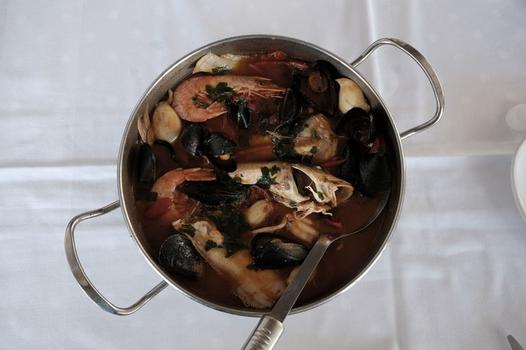 fish broth in pot Seafood Tomato Sauce Typical Bowl Broth Close-up Fish Food Food And Drink Freshness Healthy Eating High Angle View Indoors  Kitchen Utensil Mussels No People Octopus Pot Ready-to-eat Serving Size Still Life