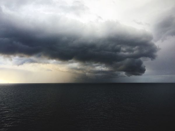 Sea Horizon Over Water Sky Cloud - Sky Water Nature Scenics Beauty In Nature Weather Atmospheric Mood Dramatic Sky Tranquil Scene Storm Cloud No People Thunderstorm Outdoors Lightning Power In Nature Day