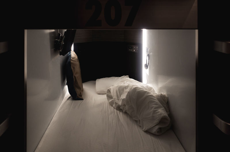 Bed Business Japan Japan Lovers Japanese Culture Japanese Style Narrow Tokyo Travel Trip Abstract Adult Bed Bedroom Capsule Hotel Cheap Curiosity Day Domestic Room Full Length Furniture Good Night High Angle View Home Interior Hotel Room Illuminated Indoors  Japan Travel Japan Trip  Journey Lifestyles Light And Shadow Low Cost Men One Person Pillow Real People Relaxation Simplicity Sleep Sleeping Standing Capture Tomorrow