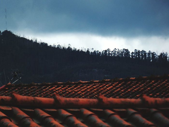 Panoramic shot of roof and building against sky