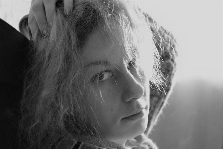 Close-up of beautiful woman looking at camera