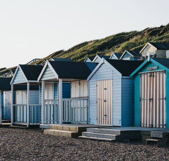 Colorful beach huts during sunset by the sea, holiday and travel concept.