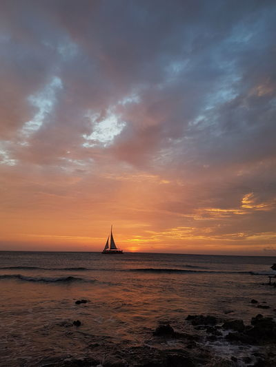 puurnatuur Aruba Photography EyeEm Selects City Nautical Vessel Sunset Water Sea Cityscape History Business Finance And Industry Arts Culture And Entertainment Sky Postcard Seascape Sailboat Horizon Over Water Sailing Lighthouse Tranquil Scene Sailing Boat Calm