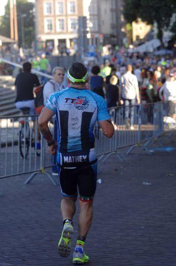 Running Sportsphotography TRIATHLON Ironman City TriathlonLife Male Back City Street Crowd People Watching Athlete Challange Going The Distance Miles Maasstricht/Netherlands Ironman Action