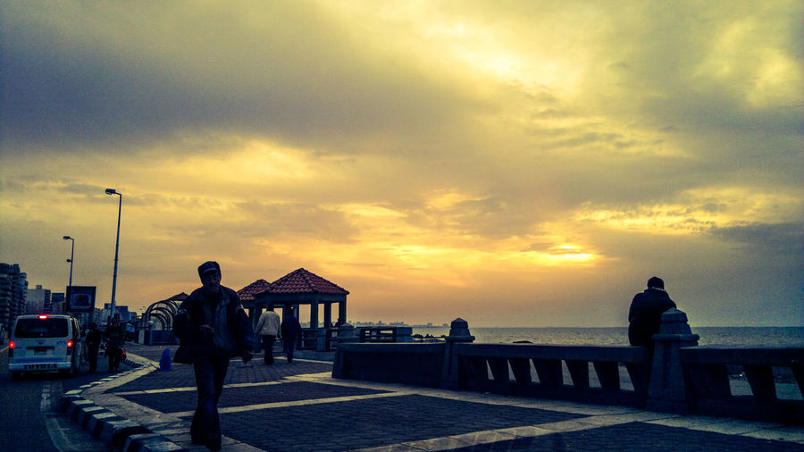 The City Light Sunset Sky Cloud - Sky Full Length Dramatic Sky Sea People Women Adult Outdoors Togetherness Adults Only Day Sea And Sky Horizon Alexandria Egypt Eyeem Photography Fresh On Eyeem  City