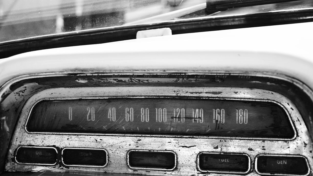 Close-Up Of Old Speedometer In Car