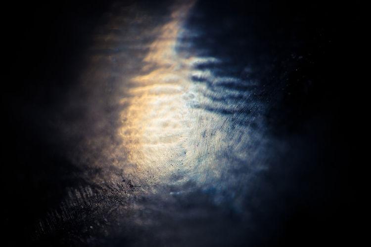 Close-up of illuminated street light against dark sky