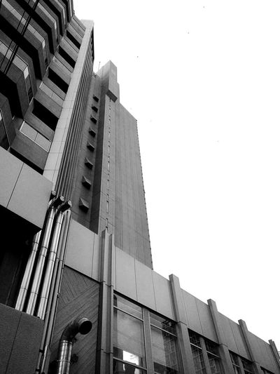 hard - edge Architecture Building Exterior Built Structure Low Angle View Clear Sky City Tall - High Building Skyscraper Office Building Building Story No People Architectural Detail Architecture Architecture_collection Composition Blackandwhite Photography TakeoverContrast Pivotal Ideas MonochromePhotography Abstract Photography Black&white Structures & Lines Monochrome Photography Geometric Shape
