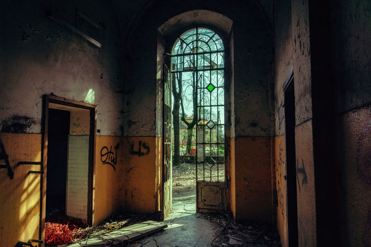 Mental Hospital  Architecture Indoors  Entrance Door Abandoned Window Building Built Structure No People Old Arch Damaged Day Run-down Absence Obsolete House Decline Deterioration History Messy Ruined