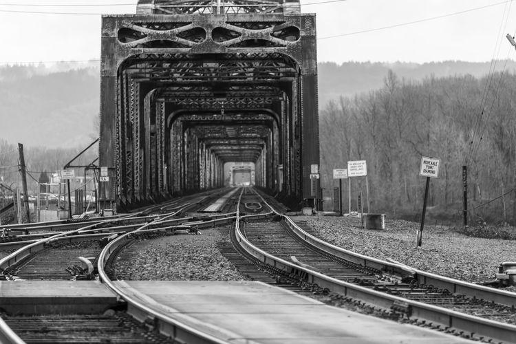 View of railroad tracks against bridge