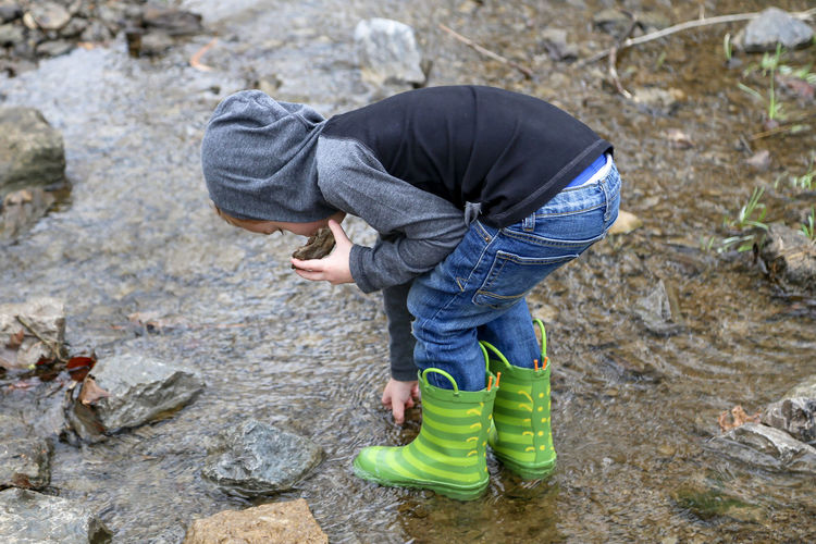 Child playing in the creek One Person Nature Childhood Day Lifestyles Child Water Outdoors Rubber Boot Jeans Boot Boy Boy Playing In Creek Child Playing In Creek Rain Boots Creek Outdoor Fun Childhoodunplugged Boy In Creek Boy Walking In Creek Boy Walking In Water Nature Hike Nature Walk Adventure Outdoor Adventures