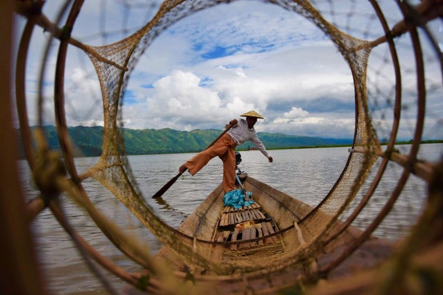 Fisher Man in Inle lake Myanmar Full Length Water Sky Real People One Person Inle lake Myanmar fisher man nautical vessel bBasketcCloud - SkydDaylLifestylestTransportationoOutdoorssShirtlessnNatureoOccupationsScenicsbBeauty In NaturemMen