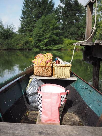 Picnic wicker baskets on boat in lake