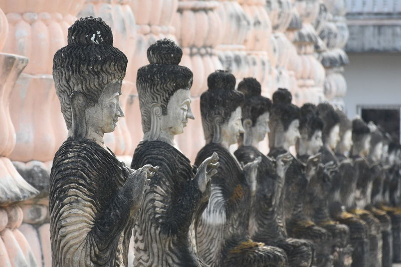 Low Angle View Of Buddha Statues At Temple