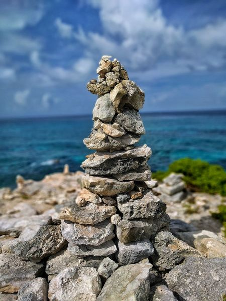 Sea Beach Horizon Over Water Rock - Object Water Nature Cloud - Sky Outdoors Day Sky No People Stack Sand Beauty In Nature Close-up Sea Life Prayer Rock Stacked Rocks Nature Photography Nomadic Life Travel Destinations Isla Mujeres Mexico EyeEm Best Shots EyeEm Travel Photography