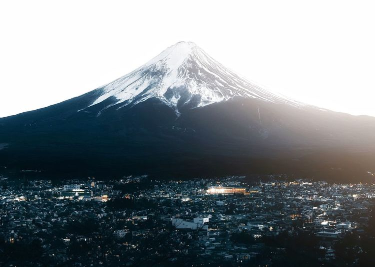 Fuji-san Mountain Snow Cold Temperature Sky Snowcapped Mountain Scenics - Nature Winter Beauty In Nature Architecture No People Nature Mountain Peak Building Exterior Environment Built Structure City Outdoors Landscape Volcano Cityscape