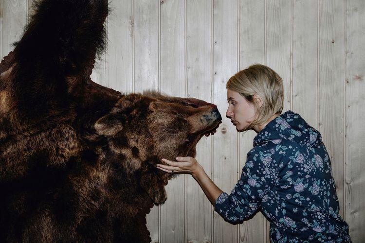 woman touching bear taxidermy