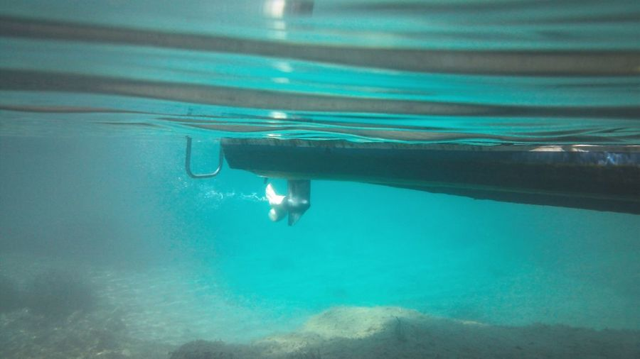 Close-Up Of Boat Bottom Underwater