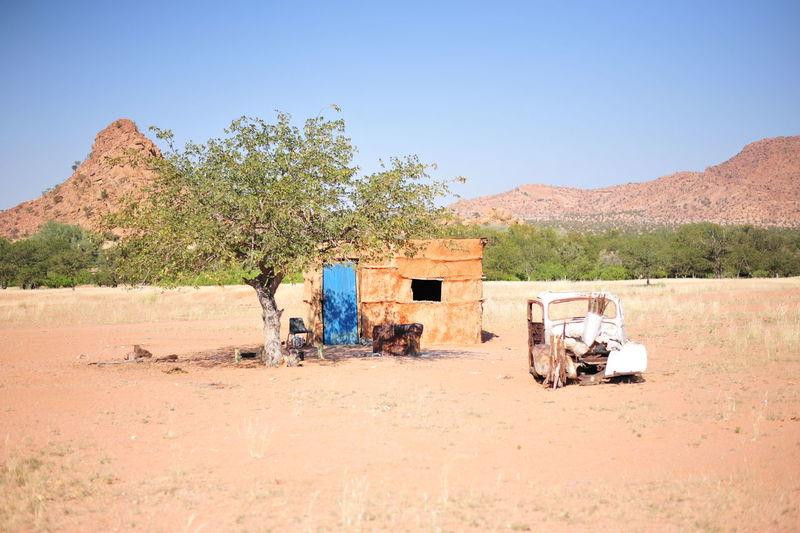 Cart in desert against clear sky