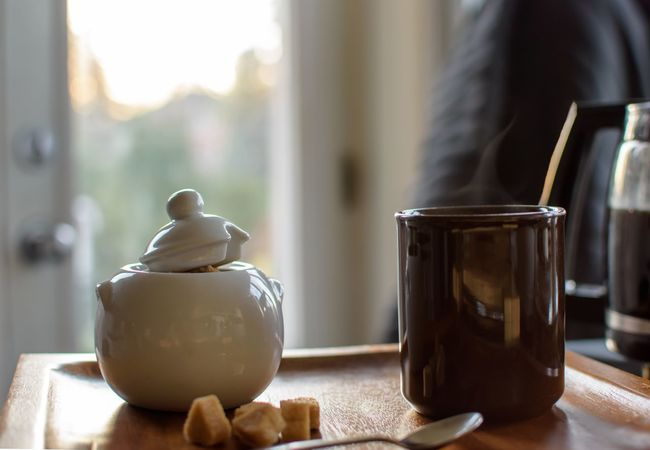 Cozy cup of coffee indoors with steamy coffee and sugar cubes on wood Raw Sugar Home Cozy Real Life Indoors  Coffee Cup Coffee - Drink Coffee Wood EyeEm Selects Indoors  Table Focus On Foreground Food And Drink Close-up Window Still Life Home Interior Tea No People Food Day Container Hot Drink Drink Freshness Tea - Hot Drink Refreshment Bowl Glass - Material Autumn Mood