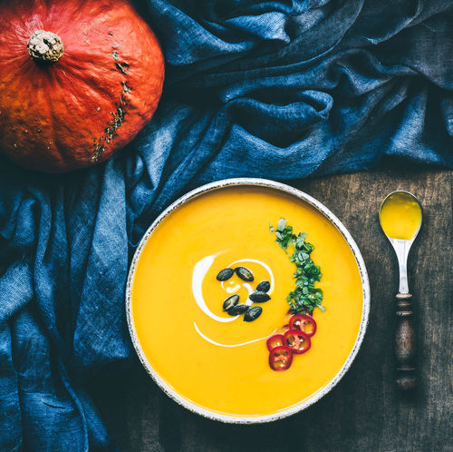 asian pumpkin soup ready to eat | daylight foodphotography martin willmann Green Homemade Food Red Spoon Blue Bowl Directly Above Food Food And Drink Food Photography Foodphotography Freshness Healthy Eating High Angle View Indoors  Nikonphotography No People Orange Color Pumpkin Ready-to-eat Soup Still Life Vegetable Yellow