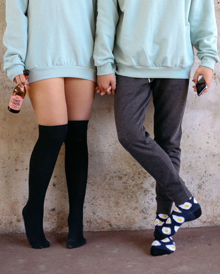 Funny socks, same coaches. Love goals. Adult Body Part Casual Clothing Couple - Relationship Front View Human Body Part Human Leg Leisure Activity Lifestyles Love Low Section Men People Positive Emotion Real People Socks Standing Togetherness Two People Women