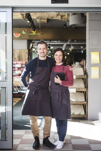 Portrait of a smiling young couple standing in store