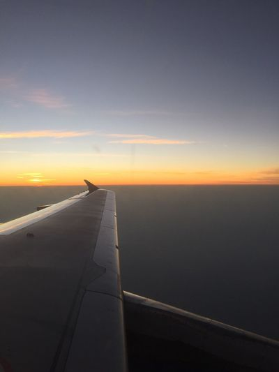 Airplane Sunset Transportation Flying Air Vehicle Sky Travel Mode Of Transport Airplane Wing Journey Scenics Nature Cloud - Sky Tranquil Scene Beauty In Nature Aerial View Outdoors No People Mid-air