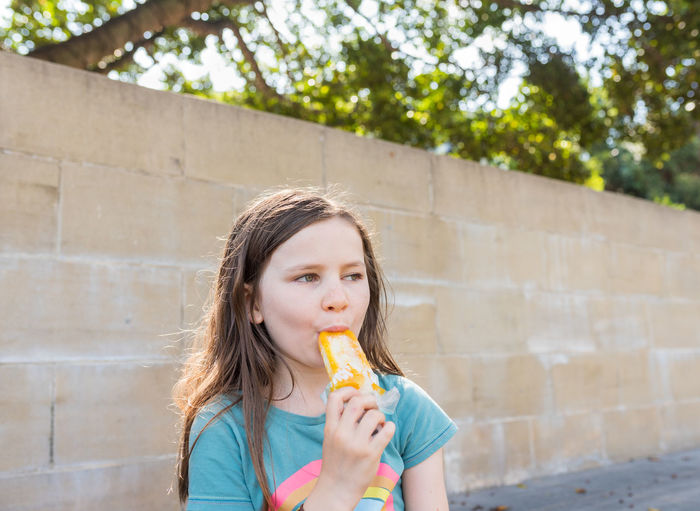 Portrait of a girl eating ice cream