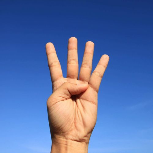 Human Hand Human Body Part Blue Day Clear Sky Low Angle View Outdoors Sky Palm Close-up One Person People Adult